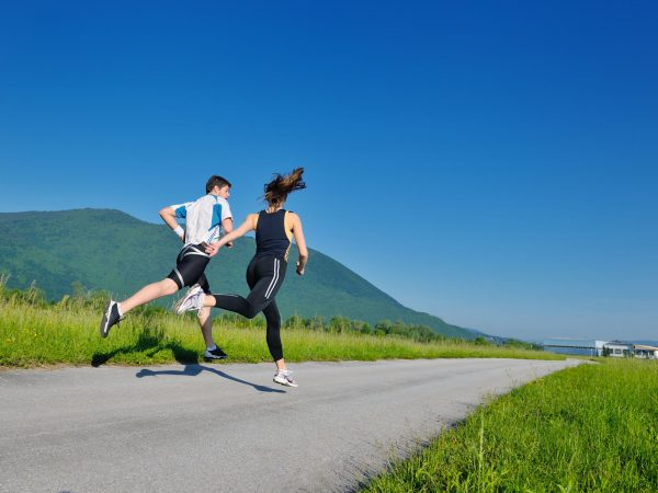 14739372 – young couple jogging in park at morning. health and fitness.